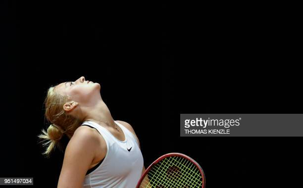 Ukraine's Marta Kostyuk reacts during her match against France's Caroline Garcia during the WTA Porsche Tennis Grand Prix in Stuttgart southwestern...