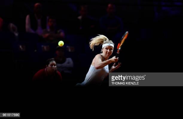 Ukraine's Marta Kostyuk returns the ball to France's Caroline Garcia during the WTA Porsche Tennis Grand Prix in Stuttgart southwestern Germany on...