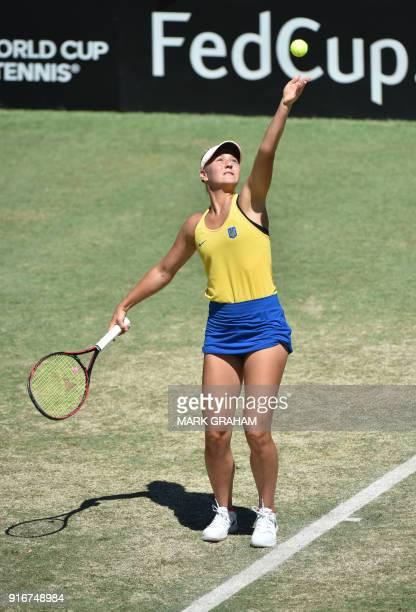 Ukraine's Marta Kostyuk serves against Australia's Ashleigh Barty in their women's reverse singles Federation Cup tennis match in Canberra on...