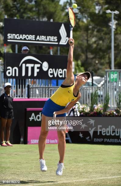 Ukraine's Marta Kostyuk serves against Australia's Daria Gavrilova during their women's singles Federation Cup tennis match in Canberra on February...
