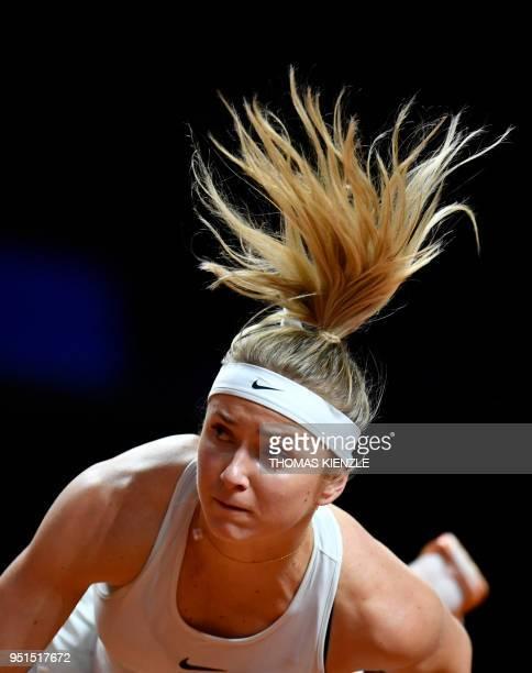 Ukraine's Marta Kostyuk serves the ball to France's Caroline Garcia during the WTA Porsche Tennis Grand Prix in Stuttgart southwestern Germany on...