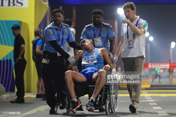 Ukraine's Maryan Zakalnytskyy receives medical attention in the Men's 50km Race Walk final at the 2019 IAAF World Athletics Championships in Doha on...