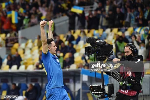 Ukraine's midfielder Mykola Shaparenko celebrates after scoring the opening goal during the FIFA World Cup Qatar 2022 Group D qualification football...
