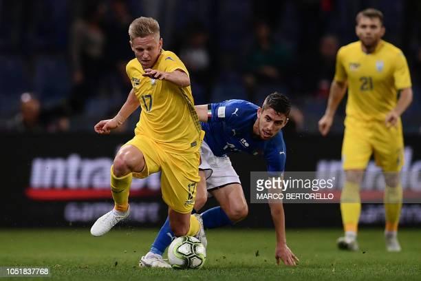 Ukraine's midfielder Oleksandr Zinchenko outruns Italy's midfielder Jorginho during the friendly football match Italy vs Ukraine on October 10 2018...