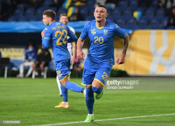 Ukraine's midfielder Oleksandr Zubkov celebrates after scoring the opening goal during the friendly football match Ukraine v Northern Ireland in...
