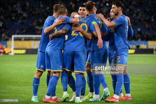 Ukraine's midfielder Oleksandr Zubkov celebrates with teammates after scoring the opening goal during the friendly football match Ukraine v Northern...