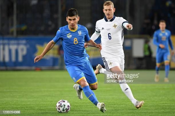 Ukraine's midfielder Ruslan Malinovskyi and Northern Ireland's midfielder George Saville vie for the ball during the friendly football match Ukraine...