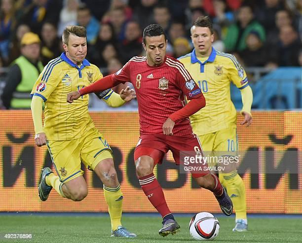Ukraine's midfielder Ruslan Rotan vies with Spain's midfielder Thiago Alcantara during the Euro 2016 qualifying football match between Ukraine and...