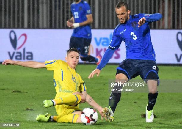 Ukraine's midfielder Serhiy Sydorchuk fights for the ball with Kosovo's midfielder Besar Musolli during the FIFA World Cup 2018 qualification...