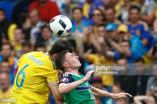 Ukraine's midfielder Taras Stepanenko and Northern Ireland's midfielder Corry Evans vie for the ball during the Euro 2016 group C football match...