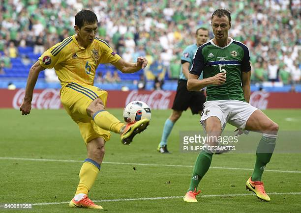 Ukraine's midfielder Taras Stepanenko vies with Northern Ireland's defender Jonny Evans during the Euro 2016 group C football match between Ukraine...