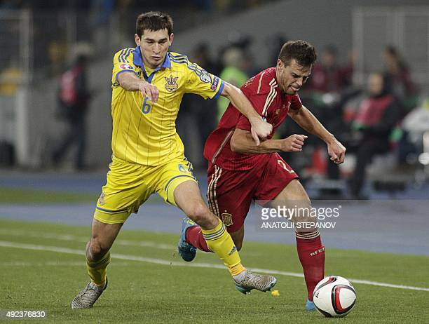 Ukraine's midfielder Taras Stepanenko vies with Spain's defender Cesar Azpilicueta during the Euro 2016 qualifying football match between Ukraine and...