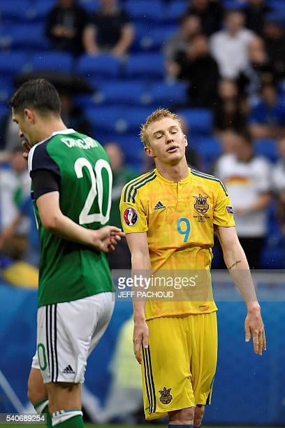 Ukraine's midfielder Viktor Kovalenko reacts next to Northern Ireland's defender Craig Cathcart after the Euro 2016 group C football match between...