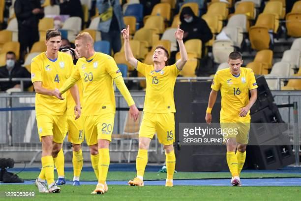 Ukraine's midfielder Viktor Tsyhankov celebrates with teammates after scoring a goal during the UEFA Nations League football match between Ukraine...