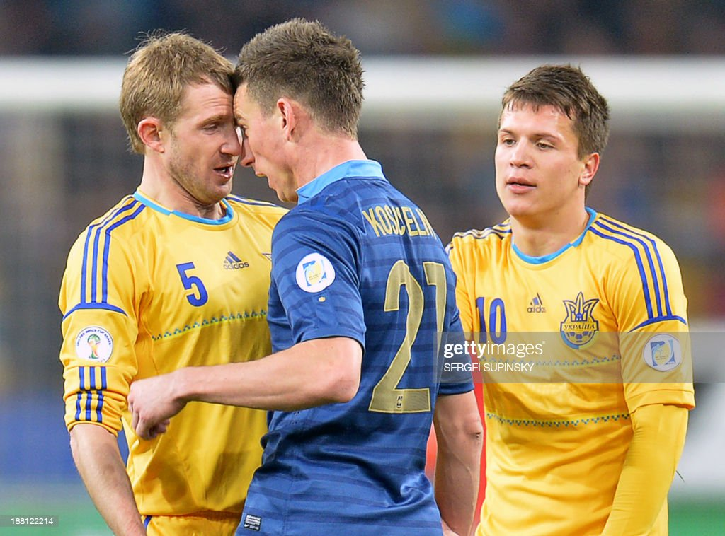 Ukraine's midfielder Yevhen Konoplyanka (R) tries to stop an argument between France's defender Laurent Koscielny (C) and Ukraine's defender Oleksandr Kucher (L) before they were both sent off during the 2014 FIFA World Cup qualifying play-off first leg football match between Ukraine and France at the Olympic Stadium in Kiev on November 15, 2013.