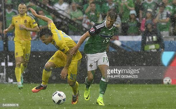 Ukraine's midfielder Yevhen Konoplyanka vies with Northern Ireland's midfielder Jamie Ward during the Euro 2016 group C football match between...
