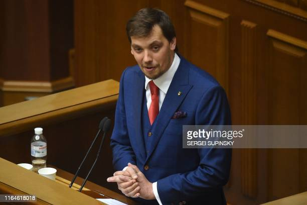 Ukraine's MP Oleksiy Goncharuk speaks during the first session of the new parliament, in Kiev, on August 29, 2019. - Ukrainian President is set to...