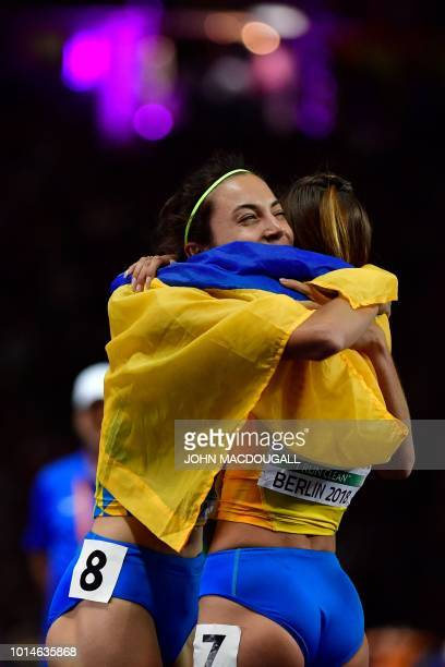 Ukraine's Nataliya Pryshchepa and Ukraine's Olha Lyakhova celebrate after the women's 800m final race during the European Athletics Championships at...