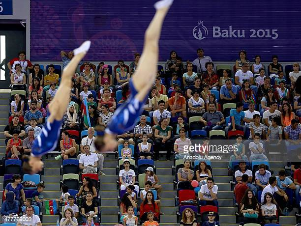 Ukraine's Natallia Moskvina and Maryna Kyiko compete in Men's Synchronised Trampoline during the Baku 2015 European Games at National Gymnastics...