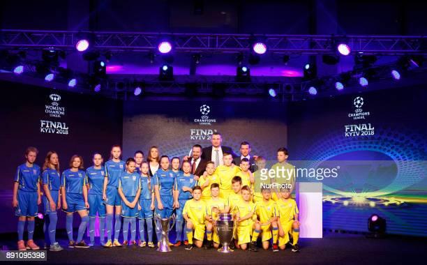 Ukraine's national soccer team coach Andriy Shevchenko and Kiev Mayor Vitali Klitschko and Ukrainian children pose with the UEFA Champions League and...