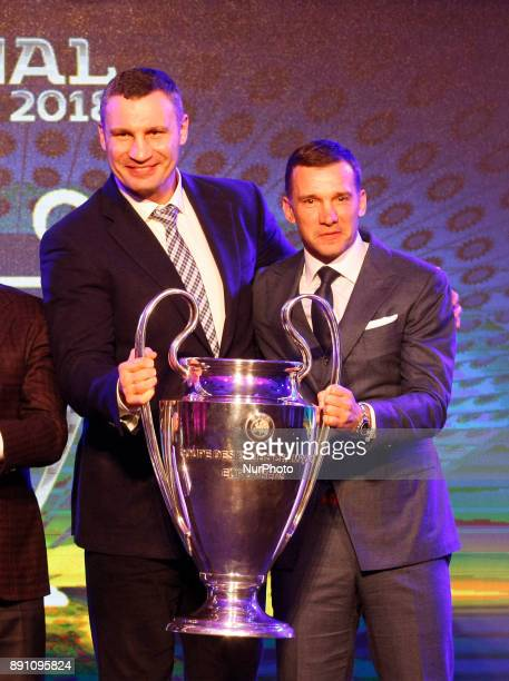 Ukraine's national soccer team coach Andriy Shevchenko and Kiev Mayor Vitali Klitschko pose with the UEFA Champions League trophy during the...