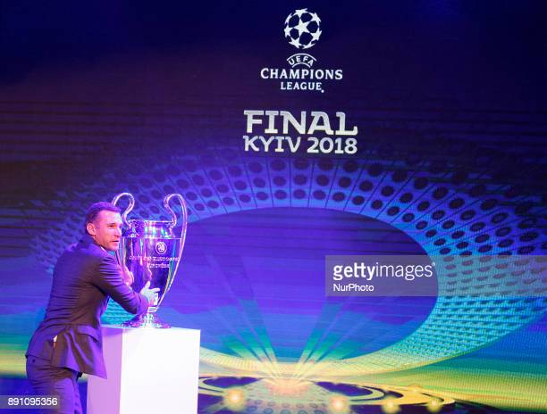Ukraine's national soccer team coach Andriy Shevchenko poses with the UEFA Champions League trophy during the presentation of the logo of the 2018...