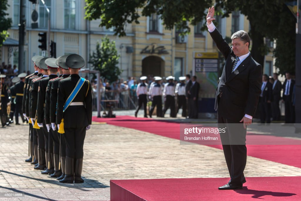 Ukraine's new president, Petro Poroshenko, waves during inaugural festivities on June 7, 2014 in Kiev, Ukraine. Poroshenko was elected on May 25 with a majority in the country's first round of presidential voting.