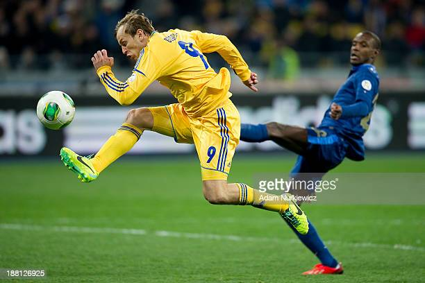 Ukraine's Oleh Gusiev kicks the ball against Eric Abidal of France during the FIFA 2014 World Cup Qualifier Playoff First Leg soccer match between...