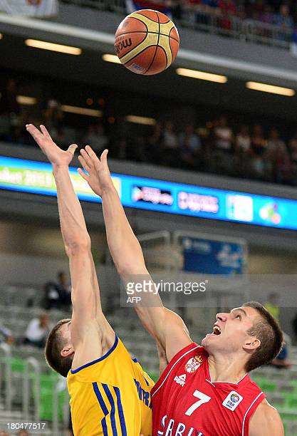 Ukraine's Oleksandr Lypovyy challenges Serbia's Bogdan Bogdanovic during the 2013 EuroBasket Championship second round match between Ukraine and...