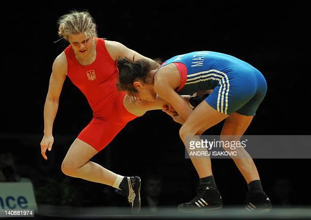 Ukraine's Oleksandra Kogut fights with Poland's Iwona Nina Matkowska during the 51 kg freestyle woman final of the European Wrestling Championship in...