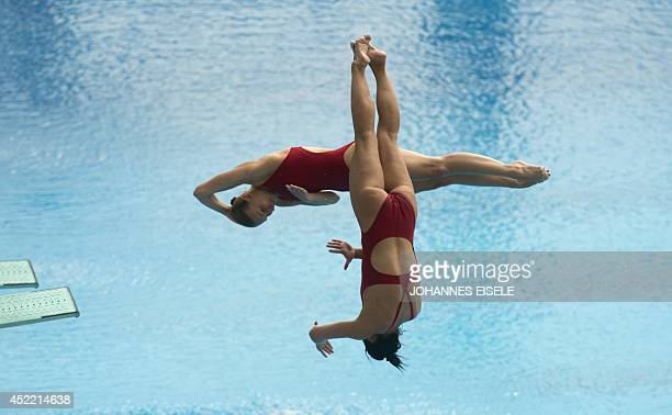 Ukraine's Olena Fedorova and Anna Pysmenska dive to finish 6th of the Women's 3M Synchro Springboard Final during the 19th FINA Diving World Cup on...