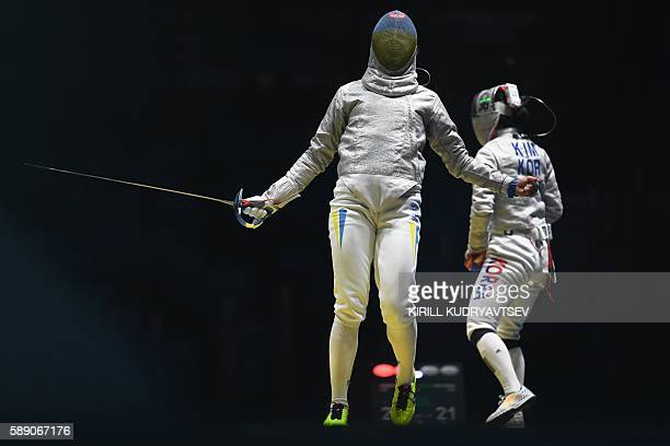 Ukraine's Olena Kravatska reacts as she competes against South Korea's Kim Jiyeon during the womens team sabre quarterfinal bout between South Korea...