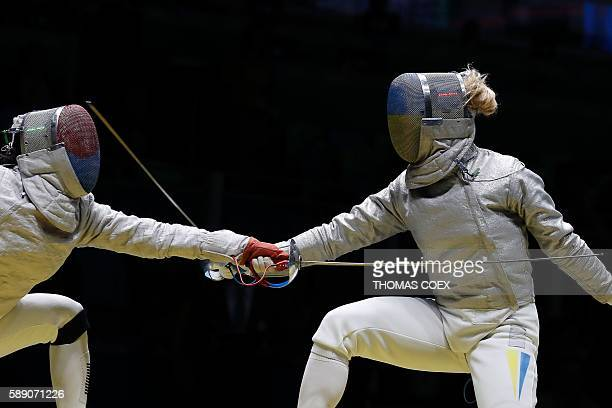 Ukraine's Olga Kharlan competes against South Korea's Kim Jiyeon during the womens team sabre quarterfinal bout between South Korea and Ukraine as...
