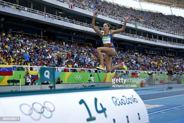 Ukraine's Olga Saladukha competes in the Women's Triple Jump Qualifying Round during the athletics event at the Rio 2016 Olympic Games at the Olympic...