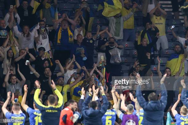 Ukraine's players and coaching staff applaud fans after the UEFA EURO 2020 round of 16 football match between Sweden and Ukraine at Hampden Park in...