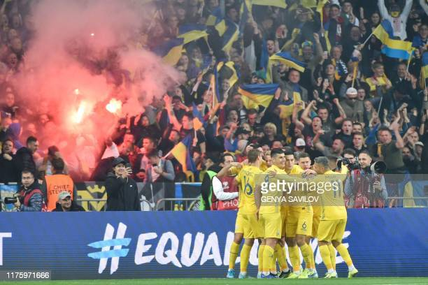 Ukraine's players celebrate a goal during the Euro 2020 football qualification match between Ukraine and Portugal at the NSK Olimpiyskyi stadium in...