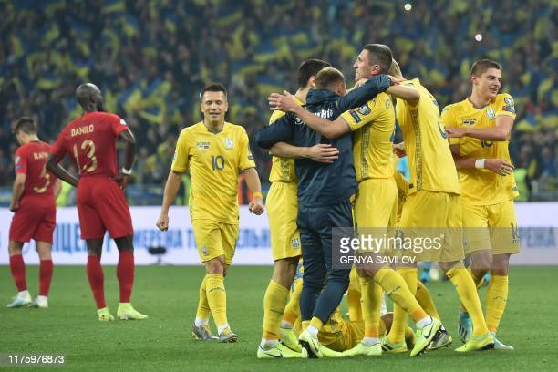 Ukraine's players celebrate after the Euro 2020 football qualification match between Ukraine and Portugal at the NSK Olimpiyskyi stadium in Kiev on...
