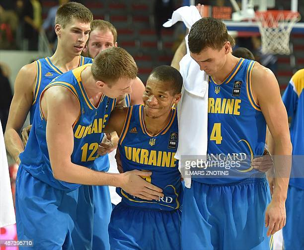 Ukraine's players celebrate after the Eurobasket 2015 group D basketball match Latvia vs Ukraine in Riga on September 9 2015 AFP PHOTO/ ILMARS ZNOTINS