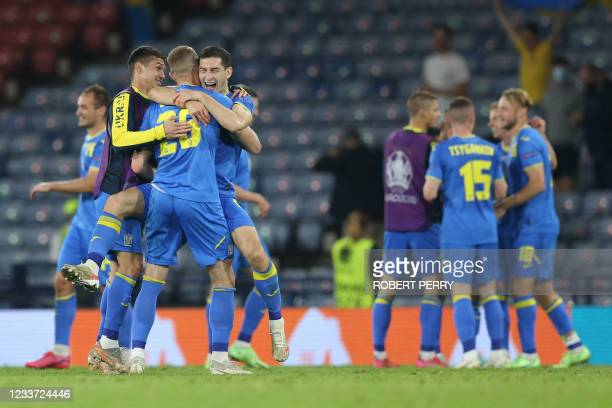 Ukraine's players celebrate after winning the UEFA EURO 2020 round of 16 football match between Sweden and Ukraine at Hampden Park in Glasgow on June...
