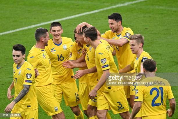 Ukraine's players celebrate scoring the equalizer during the FIFA World Cup Qatar 2022 qualification football match between France and Ukraine at the...