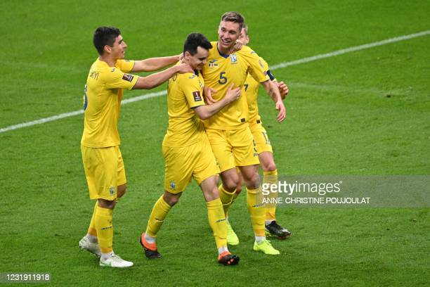 Ukraine's players celebrate their goal during the FIFA World Cup Qatar 2022 qualification football match between France and Ukraine at the Stade de...