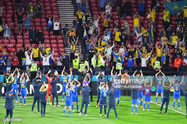 Ukraine's players celebrates with supporters after winning the UEFA EURO 2020 round of 16 football match between Sweden and Ukraine at Hampden Park...