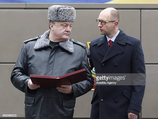 Ukraine's President Petro Poroshenko and Ukrainian Prime Minister Aresniy Yatsenyuk talk after visiting the National Guard Training Center in Novy...