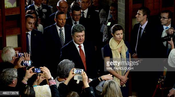 Ukraine's President Petro Poroshenko arrives with his wife Maryna and Australia's Prime Minister Tony Abbott to attend a church service at the...