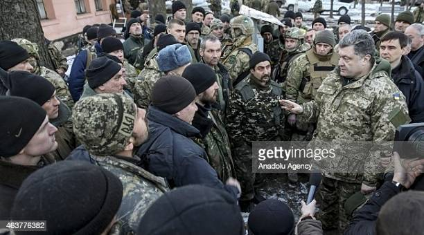 Ukraine's President Petro Poroshenko inspects troops retreated from Debaltseve district of Donetsk after clashes against ProRussian groups in...