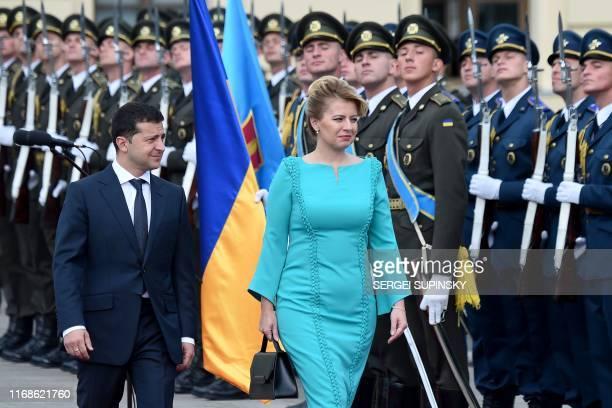 Ukraine's President Volodymyr Zelensky and his Slovakian counterpart Zuzana Caputova review the Ukrainian guard of honour during a welcome ceremony...