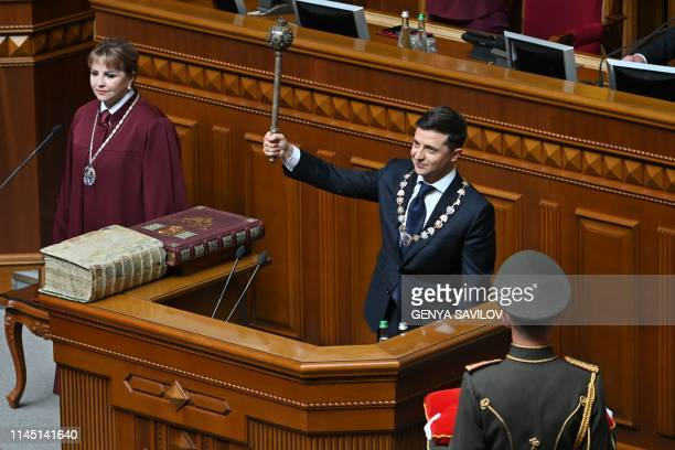 Ukraine's President Volodymyr Zelensky holds Bulava the Ukrainian symbol of power during his inauguration ceremony at the parliament in Kiev on May...