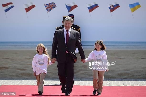 Ukraine's Presidentelect Petro Poroshenko arrives to attend the international DDay commemoration ceremony in Ouistreham on June 6 marking the 70th...