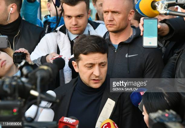 Ukraine's presidential candidate who led the first round of presidential polls Volodymyr Zelensky speaks to media as he leaves a private clinic after...