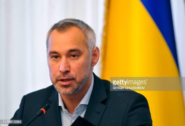 Ukraine's prosecutorgeneral Ruslan Ryaboshapka speaks to reporters during a press conference in Kiev on October 4 2019 Ukraine's prosecutorgeneral...